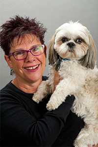 Donna Basiliou, LMT with her dog Cooper.